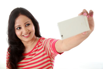 Young cheerful woman taking a selfie