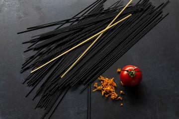 black spaghetti on black plate