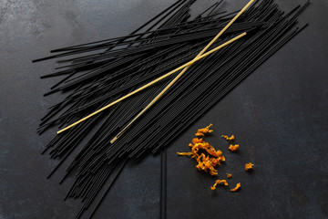 black spaghetti with spices