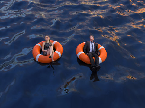 two office workers are floating on the rescue buoys, top view
