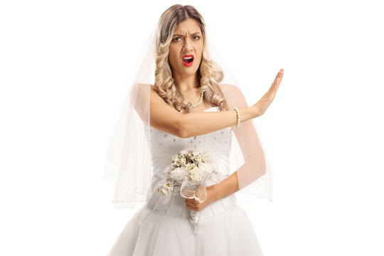 Angry bride gesturing stop with her hand