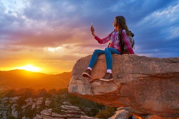 Hiker teen girl selfie phone on peak of mountain