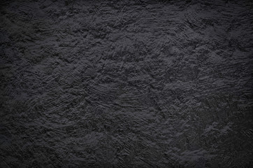 Abstract dark stucco texture for backgrounds.