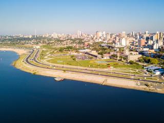 Panoramic view of skyscrapers skyline of Latin American capital of Asuncion city, Paraguay. Embankment of Paraguay river. Birds eye aerial drone photo. Ciudad de Asuncion Paraguay. South America