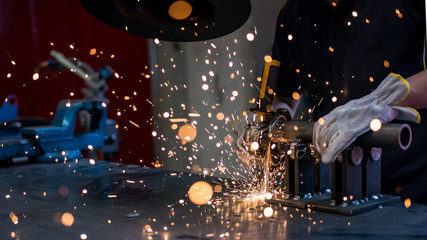 worker at work with his grinder in a metalworking industry