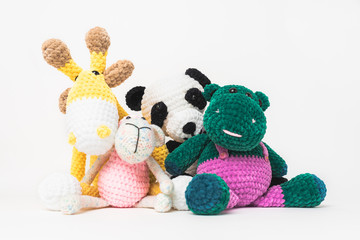 Beautiful soft group of stuffed toys, gift for a baby with thick yarn mane. hand made with crochet technique from wool yarn. White Isolated background.