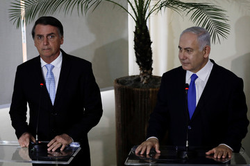 Israeli PM Netanyahu speaks next to Brazil's President-elect Bolsonaro after a lunch in Rio de Janeiro