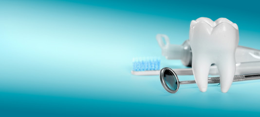 White big healthy tooth and different tools for dental care, on gradient dental background. banner size