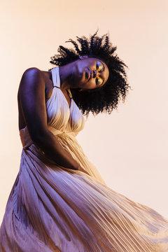 Portrait of a beautiful woman in a flowing pleated dress