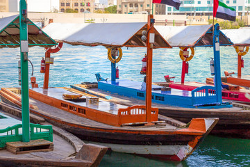 Ancient means transportation - arab boat Abra. Dubai Creek. Retro Water taxi.