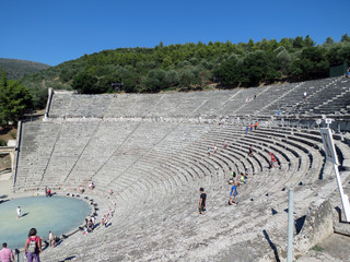 Europe, Greece, Epidaurus, many tourists come to see  the beautiful ancient amphitheater