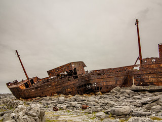 Rusted ship wreck on the rocks