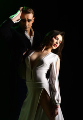 A strong attraction. Mime man and woman act in romantic scene. Theatre actors miming through body motions. Couple of mime artists perform romance on stage. Couple in love with mime makeup