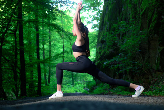 Strength and motivation. fit your body and lose weight. Healthy lifestyle concept. sportswear fashion. sporty woman training in green forest. Sport success. Fitness girl with good athlete body