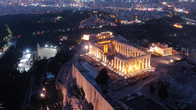 Aerial drone detail night shot of iconic Acropolis hill and the Parthenon a masterpiece of ancient Western civilisation, Athens historic centre, Attica, Greece