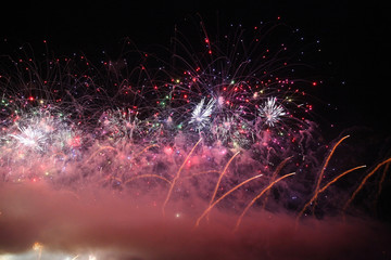 Inimitable Fireworks in the sky with gold sparks in the form of flowers