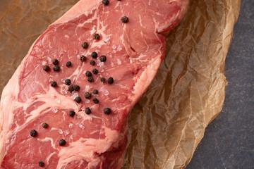 Raw New York Strip Steak on Brown Butcher Paper