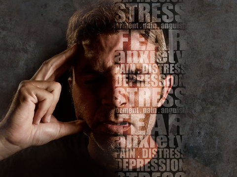 depression composite with words like pain and anxiety composed into face of young sad  man suffering stress and headache feeling sick and frustrated isolated on grunge black