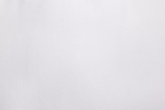 White satin fabric texture background. Soft textile material or jersey style.
