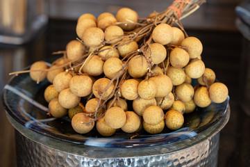 Fresh bunch of longan in glass dish
