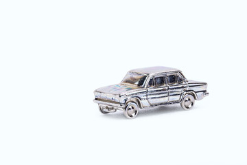 models of retro cars in miniature on white background