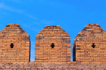 Top of wall on blue sky background at tapae gate in Chiang mai,Thailand,