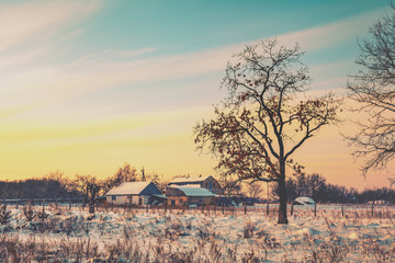 Rural winter landscape at sunset