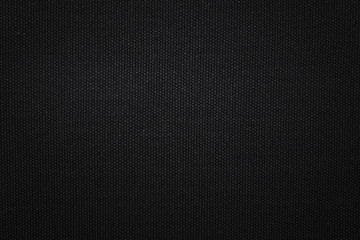 Black fabric texture background. Detail of canvas textile material.