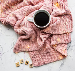 Cup of coffe, sweater and garland