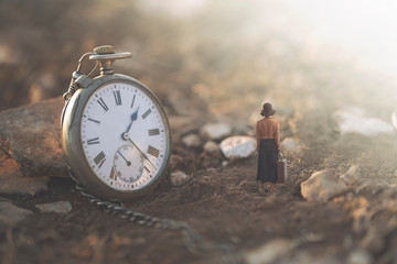 surreal image of a giant clock and a small business traveler woman Wall mural