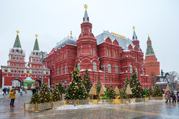 Moscow, Russia, New Year. Christmas. Festive decoration of the city. Christmas trees in front of the historical Museum.