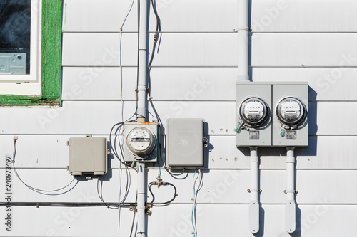 Electric Power Supply Meters And Phone Line Drop Junction Box On Exterior White Vinyl Siding Wall Of Residential House Wall Mural Pilensphoto