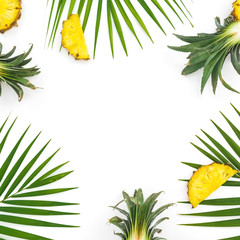 Frame with pineapple and palm leaves isolated on white background. Flat lay, top view. Tropical concept.
