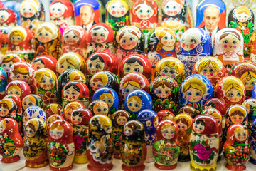 Nesting wooden dolls. Colorful Russian matryoshka at the souvenirs market