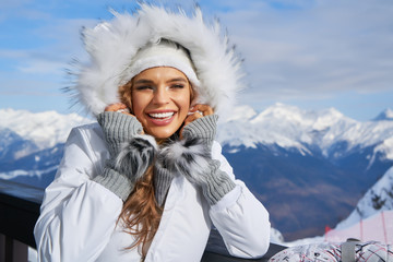 Winter woman portrait outdoors. Snow winter woman portrait outdoors on snowy white winter day