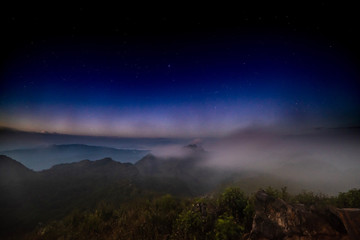 Stars on the top of a mountain covered with fog