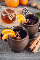 Deurstickers Marokko Hot mulled wine with orange, cinnamon, honey and anise on wooden background.
