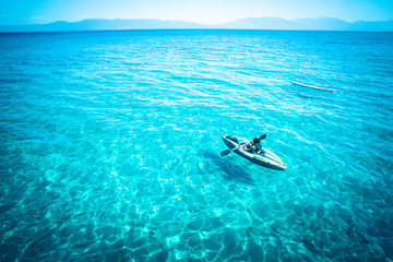 View from Lake Tahoe with tropical blue color water and canoe Wall mural