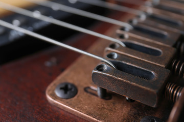 Closeup view of electric guitar, focus on bridge with strings