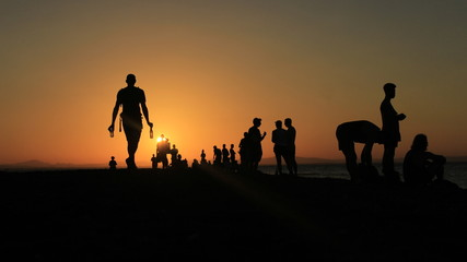 Silhouettes of  Travelers watching a Nicaraguan Sunset on Ometepe