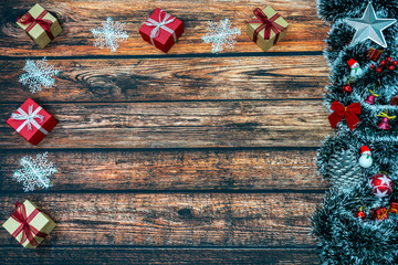 Christmas tree and Christmas gifts on wooden background. Christmas background, with place for text, copy space.