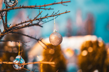 Christmas golden ball and tree branch. Christmas decorations.