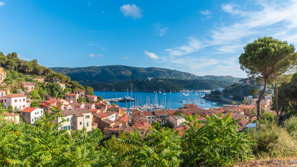 Wall Mural - Panoramic view over Harbor and village Porto Azzurro, Elba islands, Tuscany, Italy