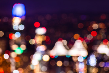 Defocused aerial night view of San Francisco financial district; background bokeh of colorful lights; abstract background