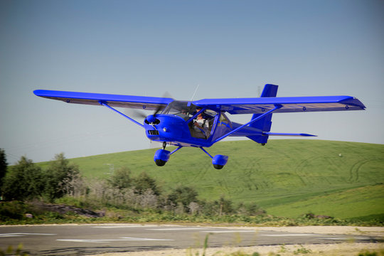 a blue plane manned by student and flight instructor of a class flight practice