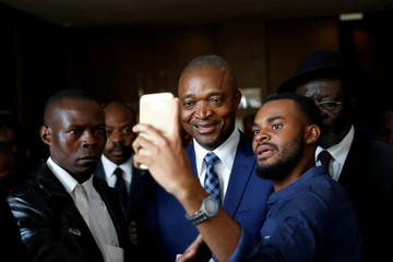 Emmanuel Ramazani Shadary, Former Congolese Interior Minister and presidential candidate, stops for a photo after a meeting in which he signed the code of good conduct ahead of December 30 elections in Kinshasa