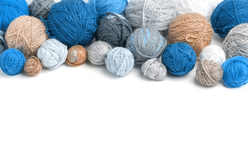 Colorful yarn balls isolated on white