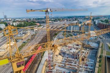 Fototapeta Budowa budynku i fundamentów. Żurawie obraz