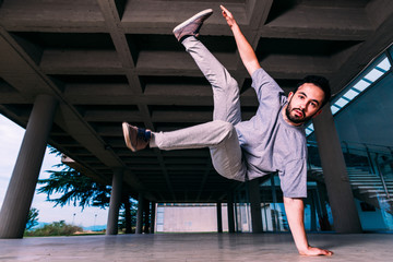 Young man practicing parkour on the ground