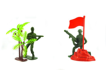 Toy soldier isolated on white background / Group of Miniature toy soldier with palm tree and flag